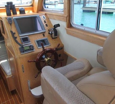 complete electronics, mahoghany wheel, helm chair elevated for cruising